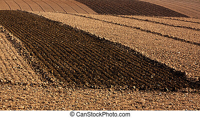 Ploughed farm fields - Freshly ploughed farm fields ready...