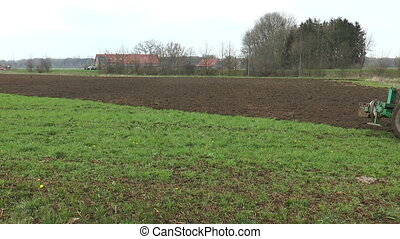 Ploughing farmland with tractor and