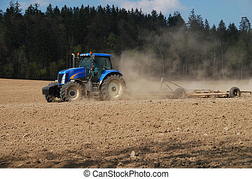 Ploughing - Tractor is ploughing a field after the summer