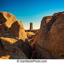 Ploumanac'h lighthouse between the rocks in pink granite coast, Brittany, France.