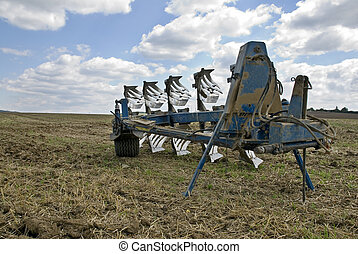 Plow in the field after the harvest