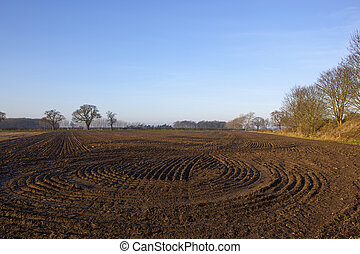 plow soil patterns - lines and patterns in a newly...