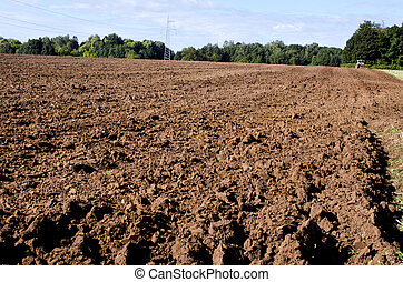 plowed autumn farm field panorama