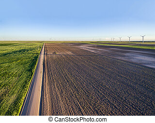 Plowed field and windmill farm