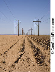 Plowed Field with High-Tension Line