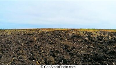 plowed land on the field - camera moves across the field...