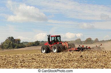 Plowing Corn Field - Red tractor plowing a field of corn...