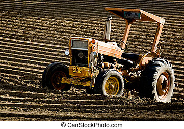 Plowing Done - A dramatic image of an old tractor parked in...