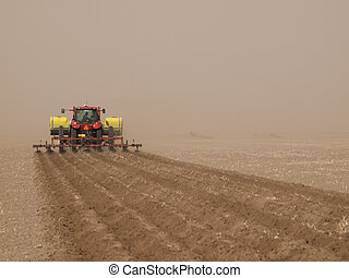 Plowing - Spring plowing in sand storm near Alamosa,...