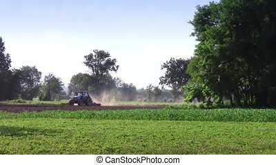 plowing - Agriculture, farmland. Landscape with tractor.