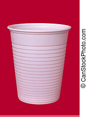 Common or garden disposable cup. Red background.
