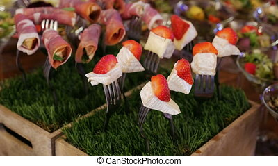 plug-and-cheese and strawberry stand in the grass in the...