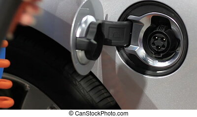 plug in electric car - Close up plugging in an electric car...