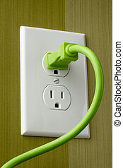 Plugged in - Bright green electrical cord is plugged into...