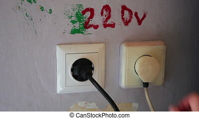 Plugging and sticking a plug into a socket
