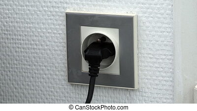 Plugging Many Different Power Plugs Into Wall Outlet - Time...