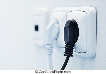 plugue elétrico, em, um, tomada
