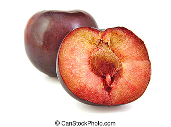 Plum and a half on white background.