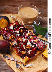 plum cake with almonds and walnuts