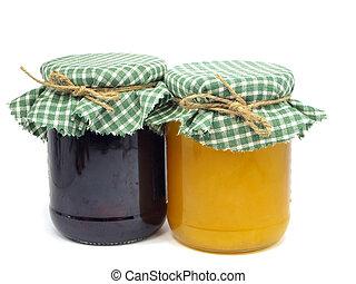 plum jam and honey in glass jars
