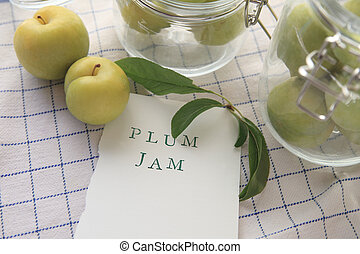 Plum jam words with glass jars
