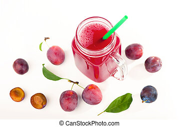 plum juice in a glass with fresh plum fruit isolated on white background