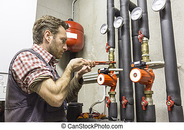 plumber at work installing a circul