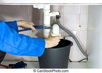 plumber drain pipes - plumber repairing a choked-up drain...