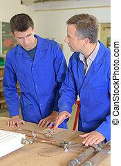 Plumber explaining to student