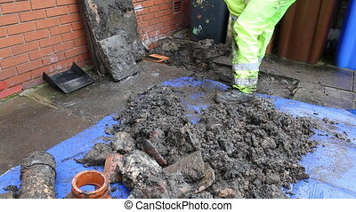 Plumber filling up hole with dirt - Plumber finished working...