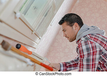 Plumber fixing a radiator