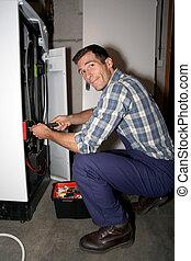 Plumber fixing heater