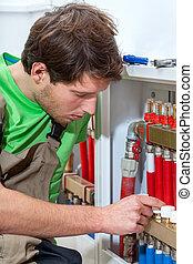 Plumber fixing the valves