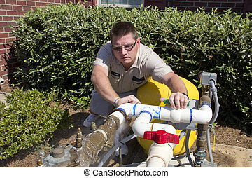 Plumber found small hole in pvc pipe that is allowing a gallon a minute to leak out on the ground, he will need to remove pcv 90 % elbow and replace it