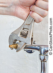 Plumber hands turned water valve faucet using plumbers ...