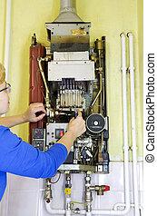 plumber heating screwdriver - plumber with screwdriver...