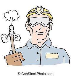 plumber holding high pressure hose