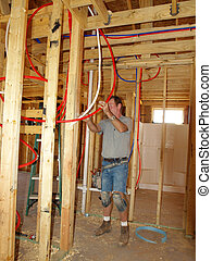 Plumber installing Pex Plumbing in new home construction