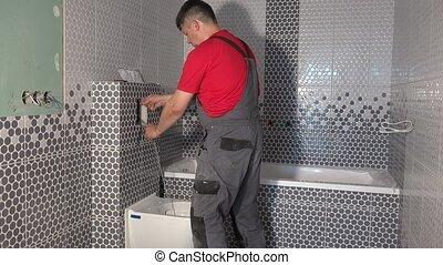 Plumber man flush water from tube of toilet flushing...