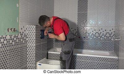 Plumber man mount toilet water flushing button in new...