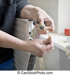 plumber radiator pliers - plumber with pliers and radiator