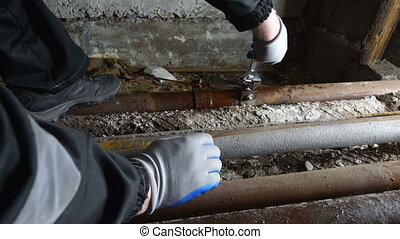 Plumber repairing leaky plumbing pipes installing pipe...