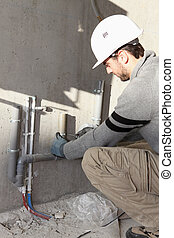 Plumber repairing water supply