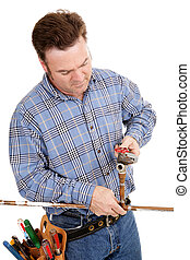 Plumber Repairs Pipe - Plumber working on a copper pipe....