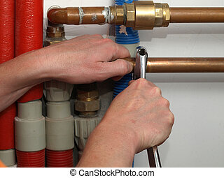 Plumber fixing pipes in a boiler room