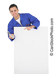 Plumber stood behind blank poster with mobile