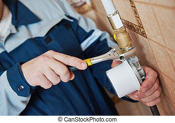 Plumber technician works with gas meter