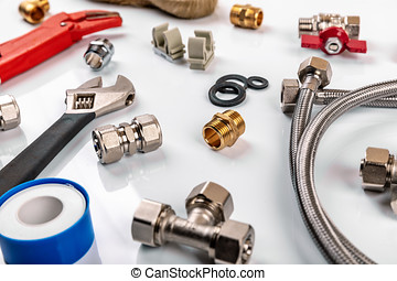 plumber tools and equipment on white background