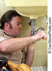 Plumber Uses Wrench