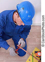 plumber using a spanner